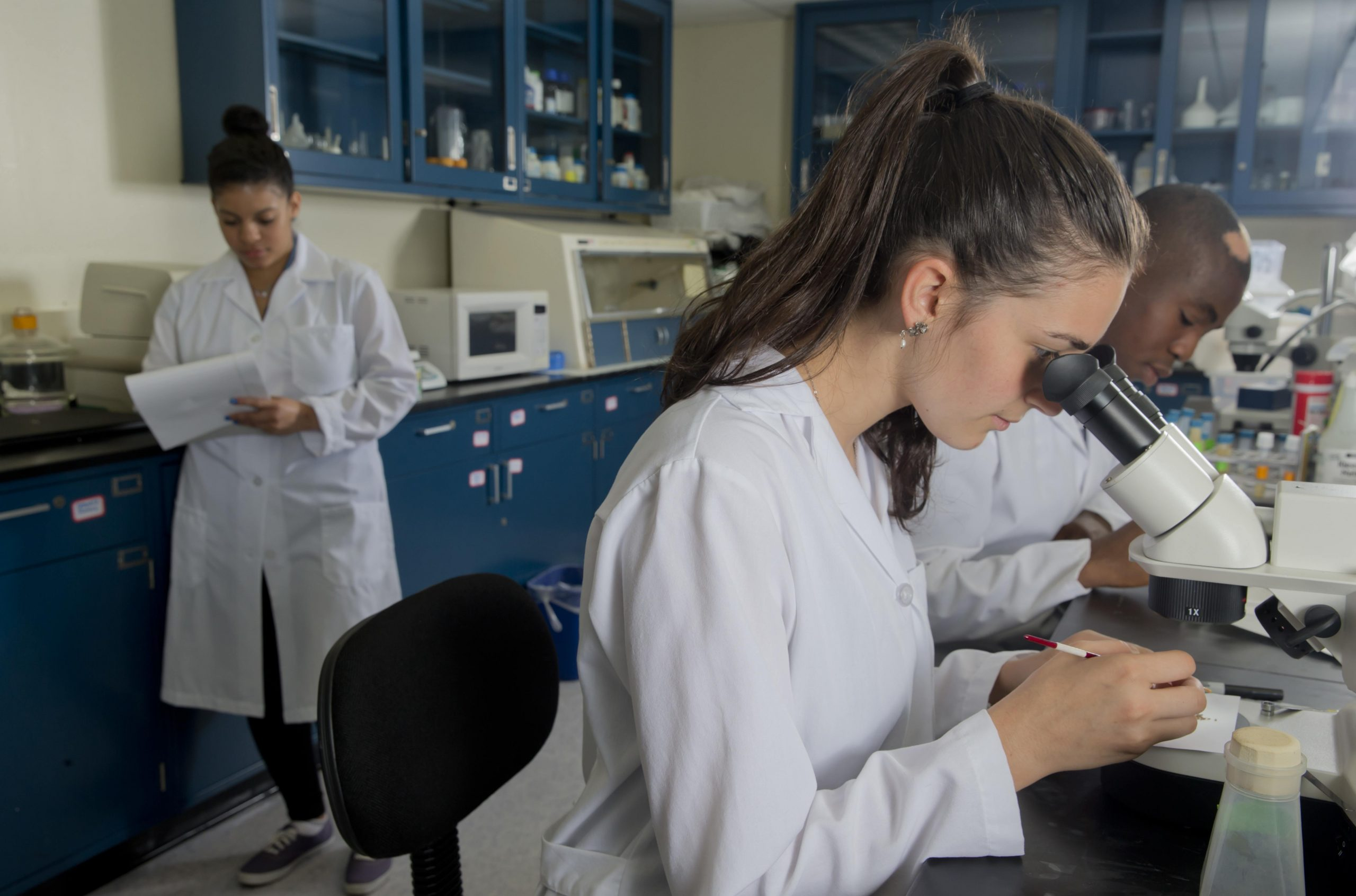 Clarkson students conducting research in a lab.